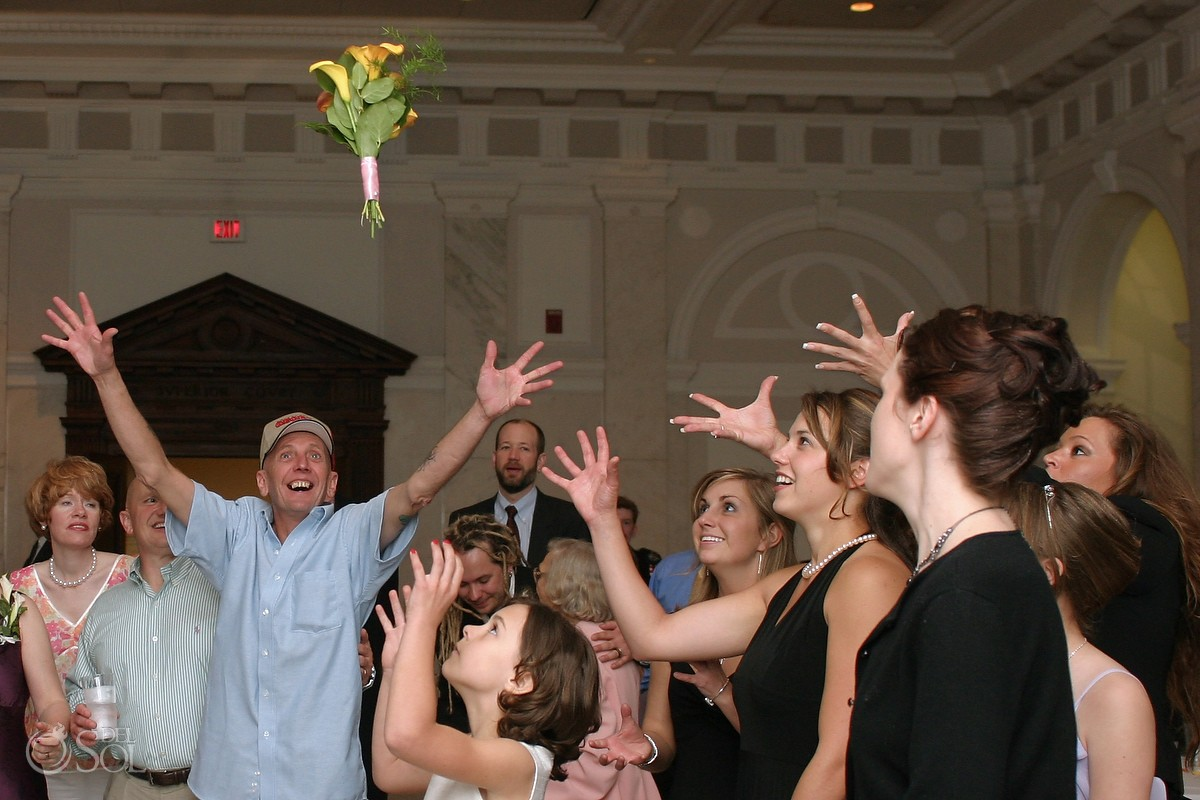 Man photobombs the tossing of the bouquet wedding