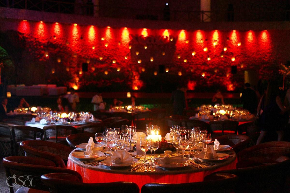 Table set ups at wedding reception at La Isla restaurant in Xcaret Park, Riviera Maya, Mexico