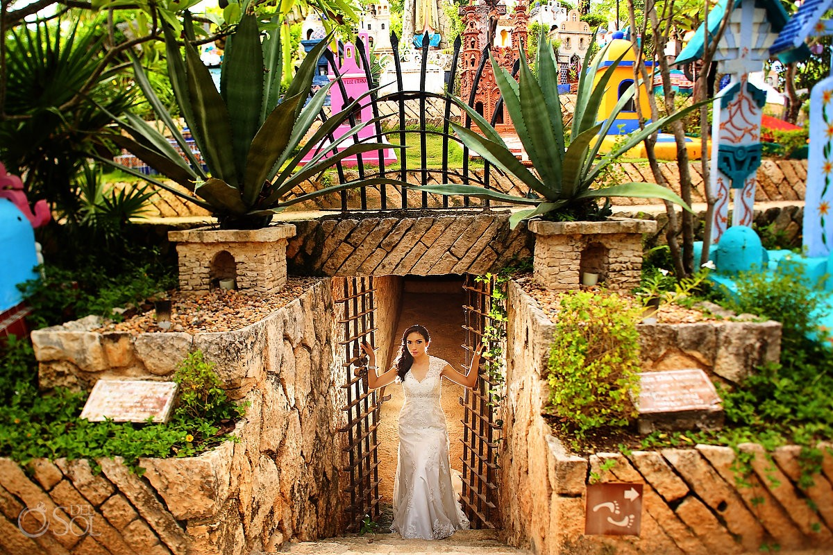 Bride wedding portrait in the colorful traditional Mexicam cemetary at Xcaret Part, Playa del Carmen, Mexico