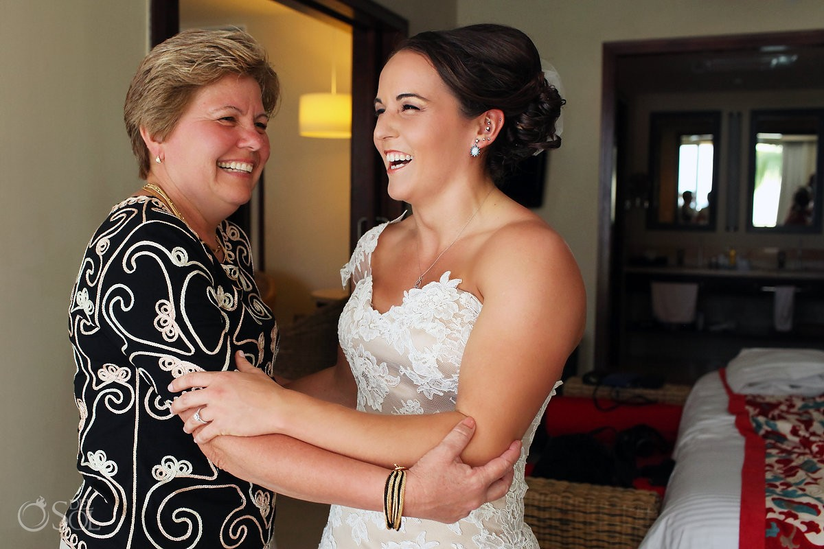 Riviera Cancun wedding at Now Jade smiling bride getting ready with mom