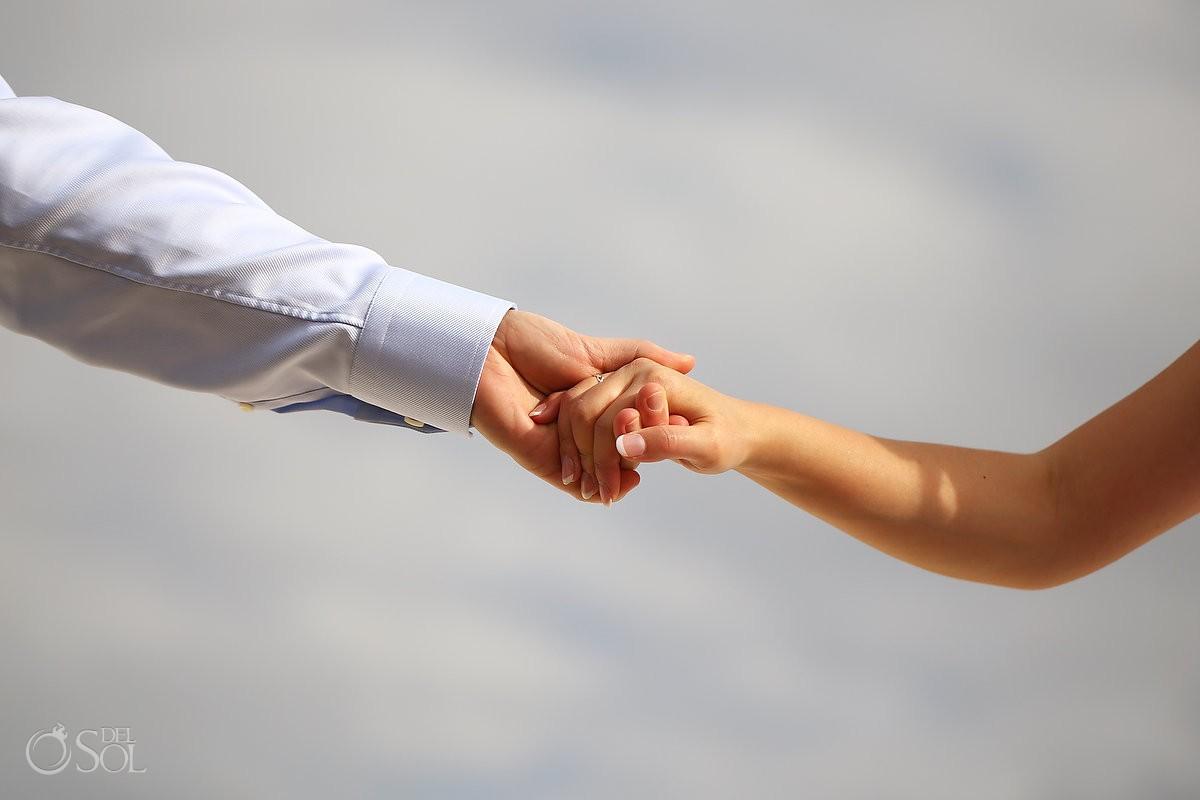 Destination wedding Iberostar Cancun newylweds hold hands