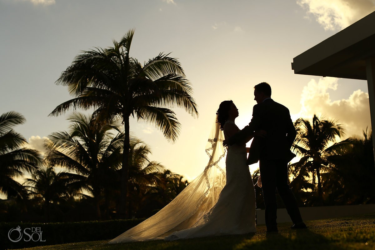 Destination wedding Iberostar Cancun newlyweds portrait sunset