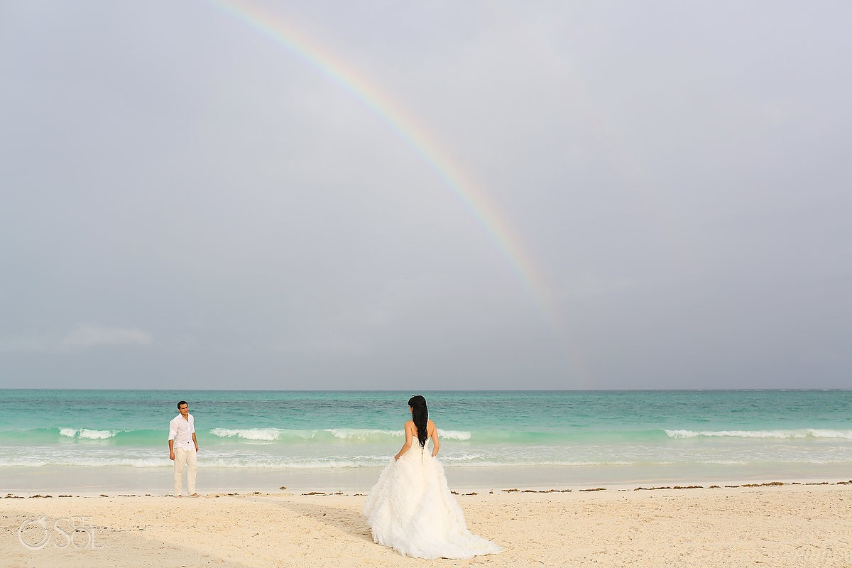 bride and groom under rainbow at Secrets Maroma destination wedding