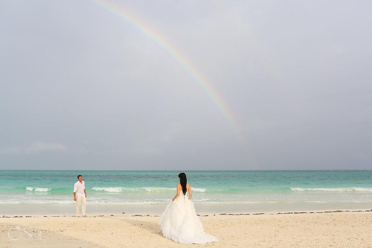 bride and groom under rainbow at Secrets Maroma destination riviera maya wedding secrets maroma