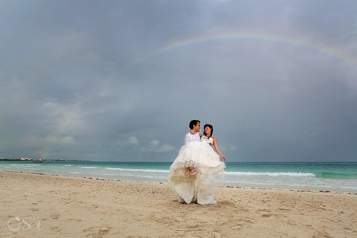 bride and groom with rainbow secrets maroma wedding photographers