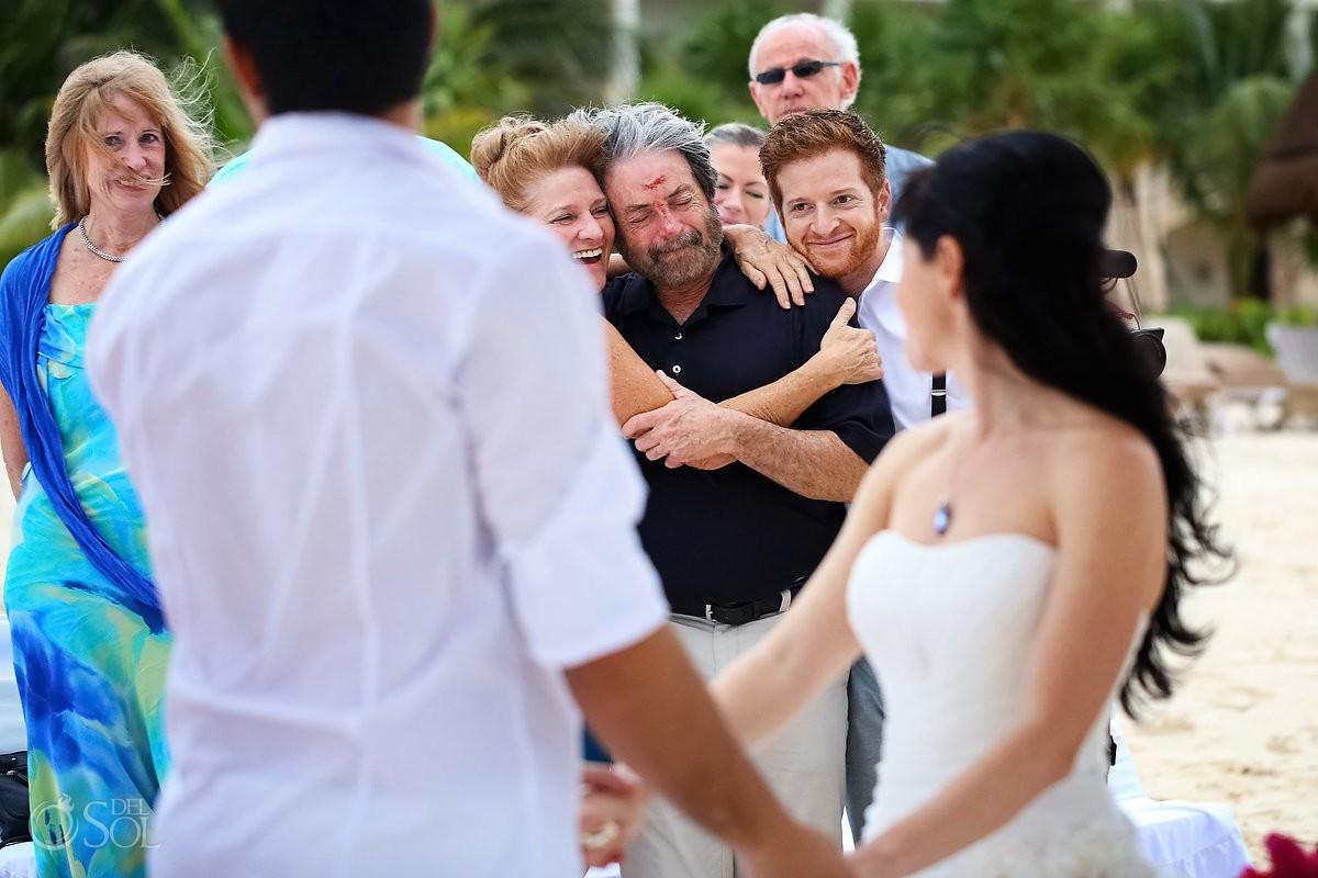 riviera maya wedding guests watching a beach ceremony