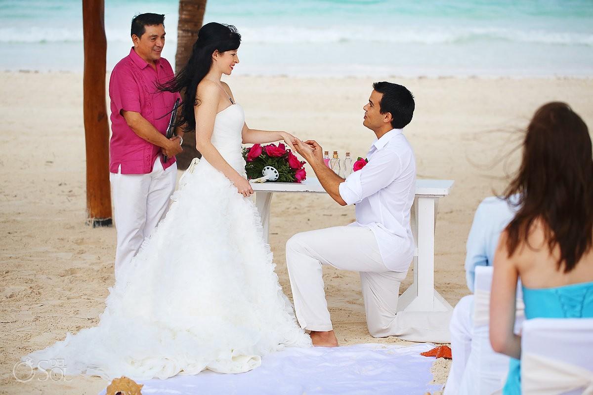 riviera maya wedding photo groom on his knees