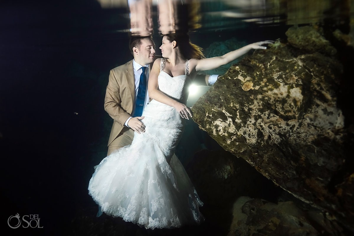 Underwater cenote bride and groom portrait