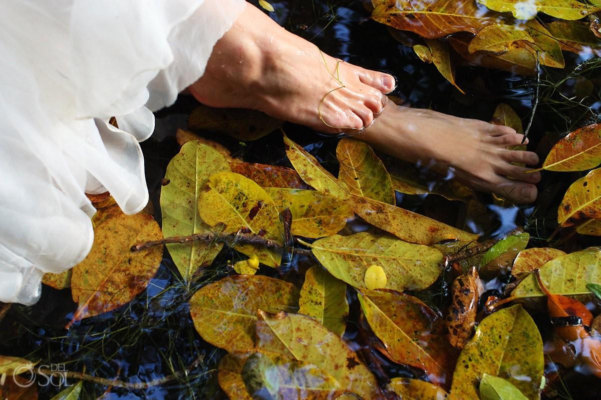 Riviera Maya trash the dress bride feet cenote lily pads