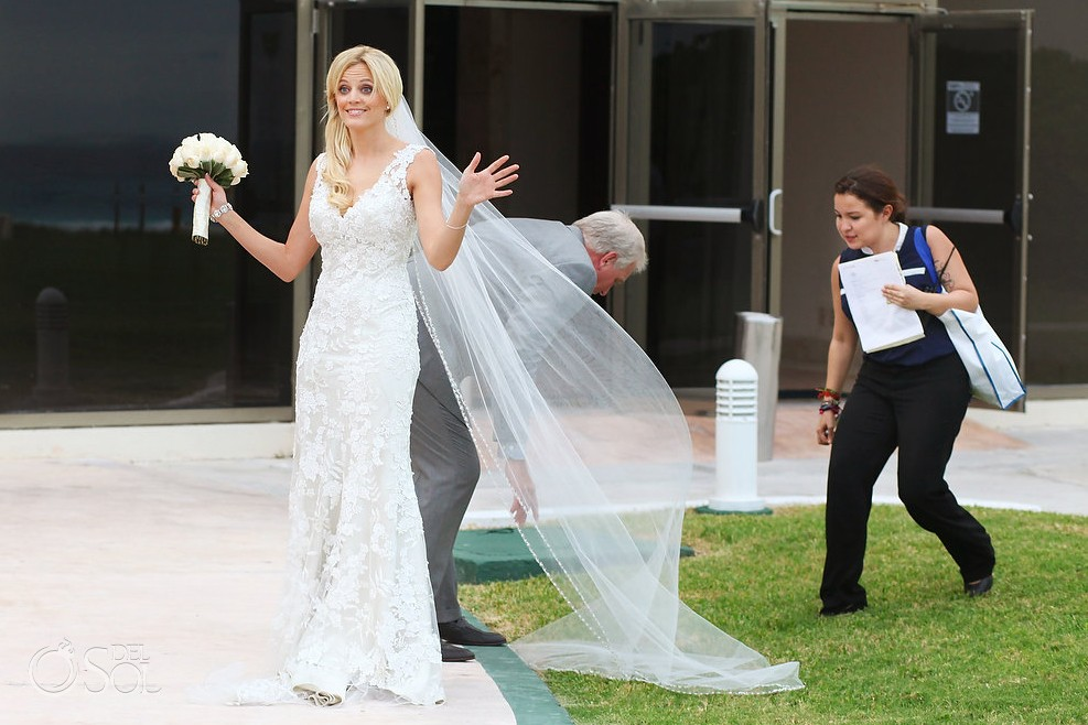 bride walking at Iberostar cancun in wedding gown by Allure bridal