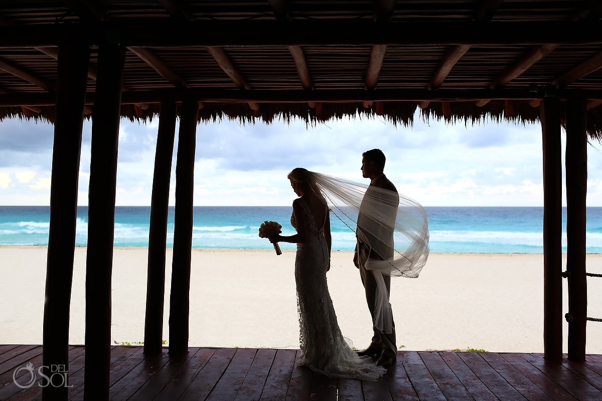 Bride and groom at Iberostar cancun ocean background