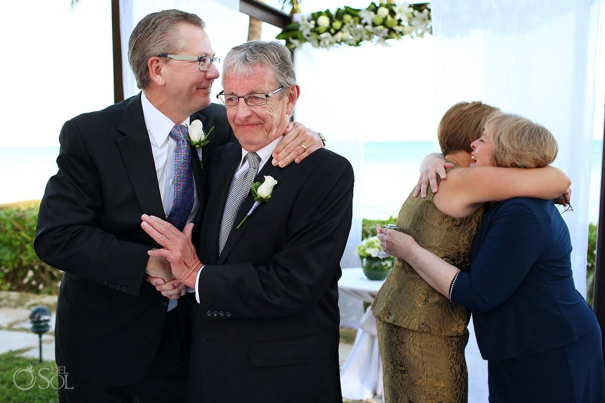emotional hugs at secrets capri wedding photographer