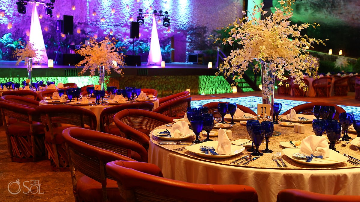 extravagant table settings at the wedding reception for 100+ guests at La Isla restaurant Xcaret Park Riviera Maya Mexico
