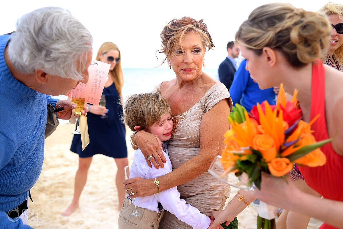 ring bearer child crying with mother during wedding ceremony
