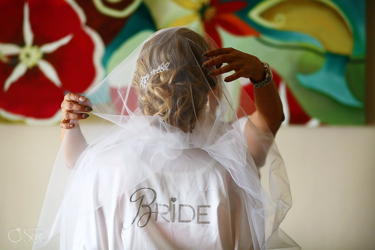 bride wearing a robe with sequin letters spelling