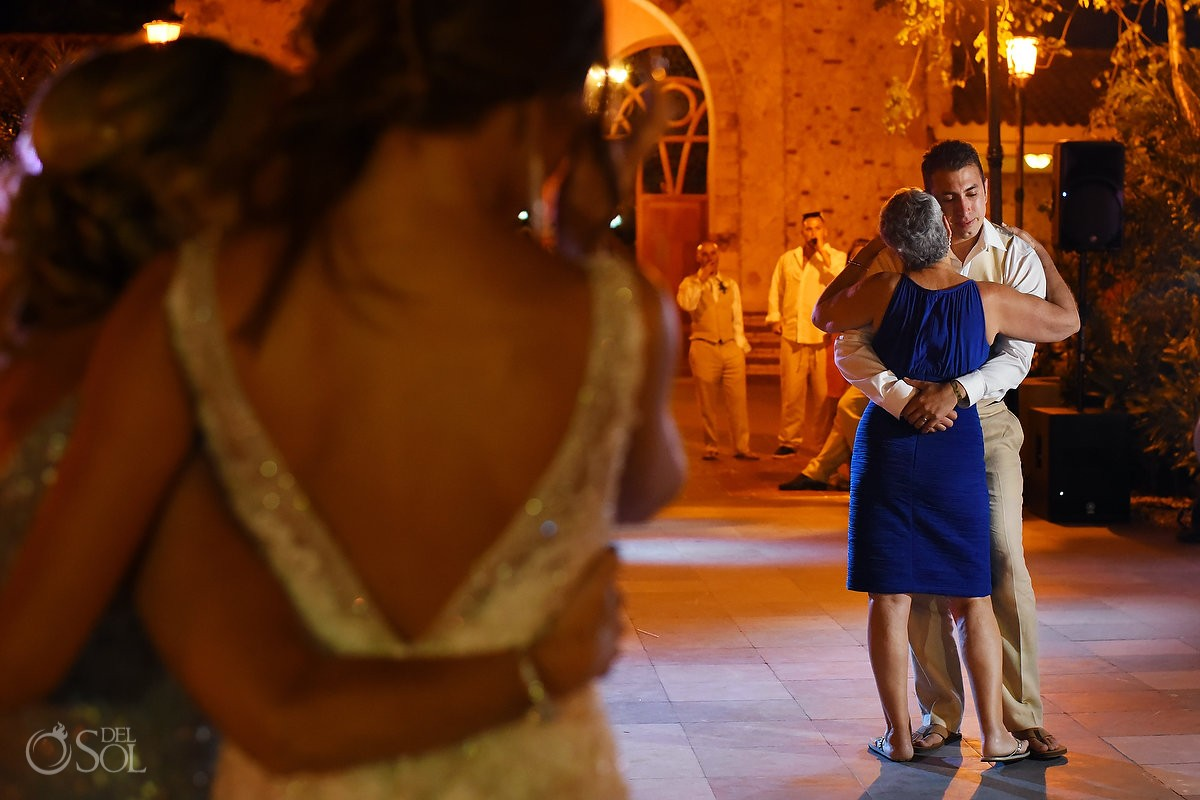 Mother and groom dance during a destination wedding in Mexico