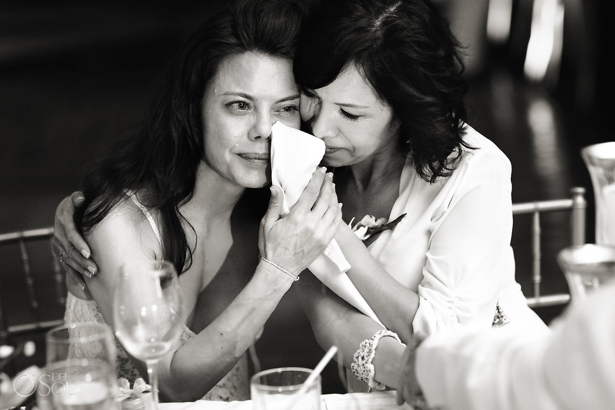 bride crying with her mother