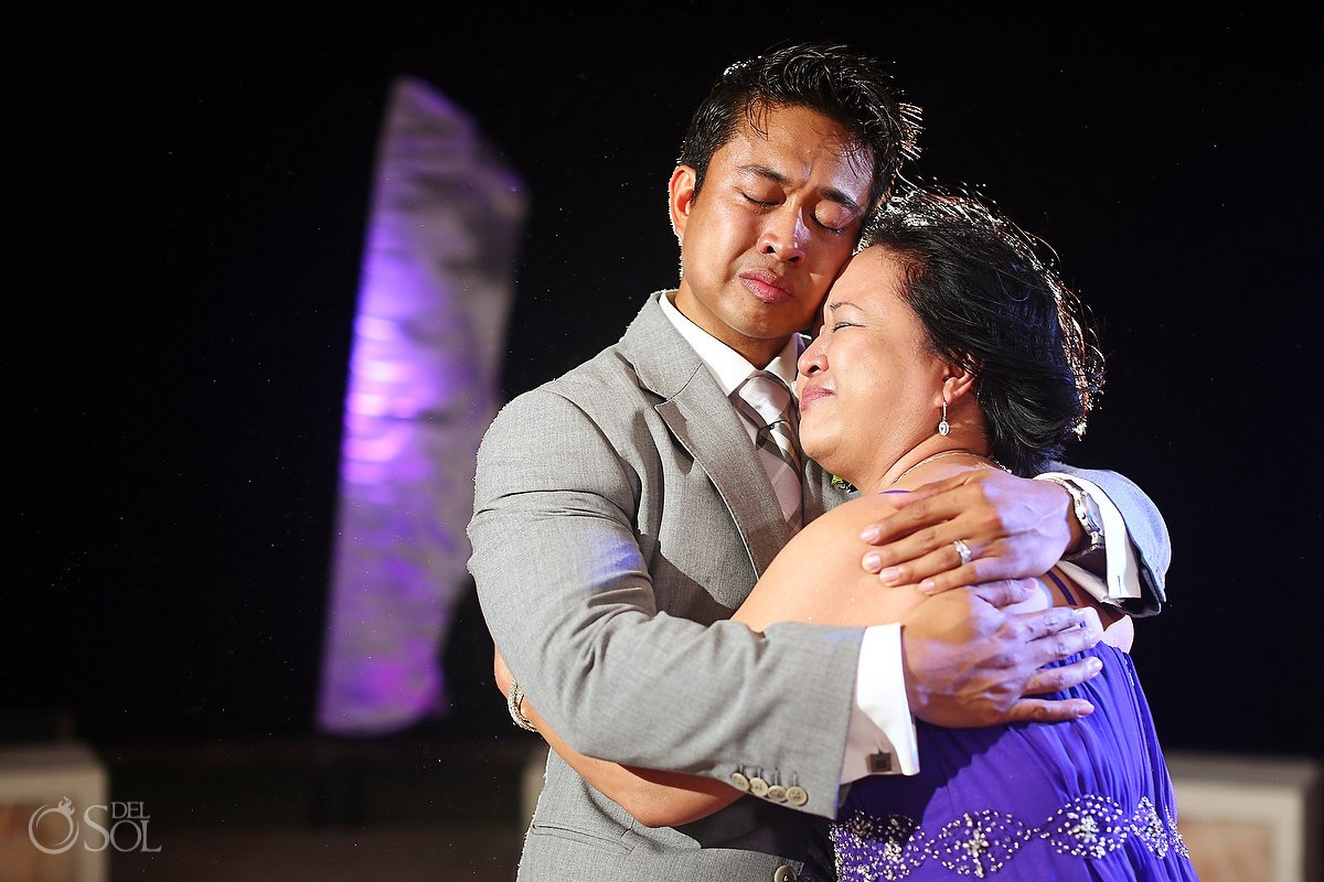 Groom and mother dance at their destination wedding in mexico