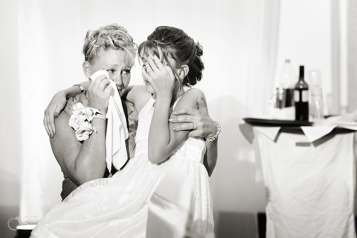 intimate family moment with bride and mother crying at wedding reception