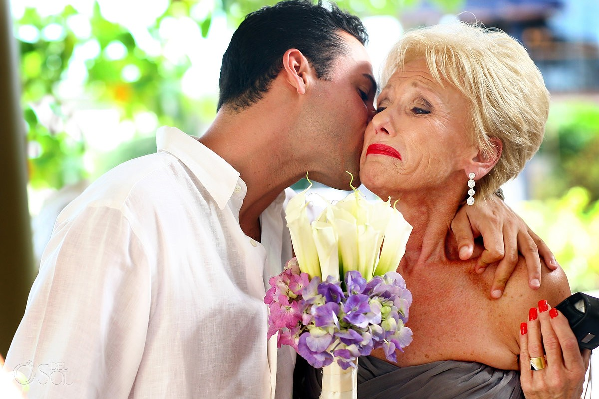 Groom kisses his mother at his destination wedding in Mexico
