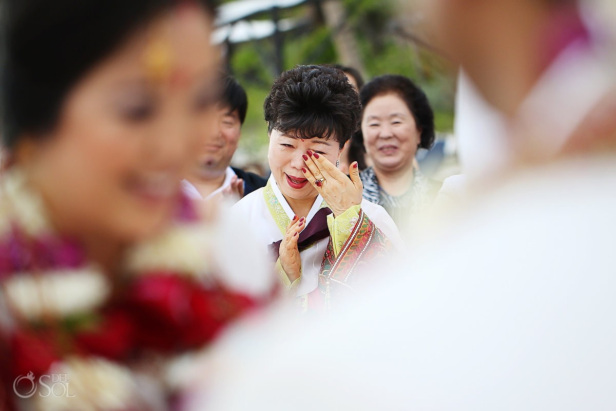 Asian mother of the bride cries at destination wedding in mexico