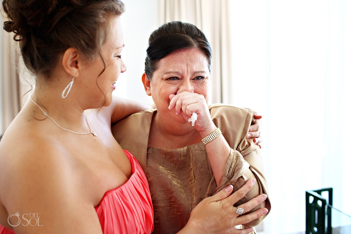 bridesmaid cries with mother at destination wedding in mexico