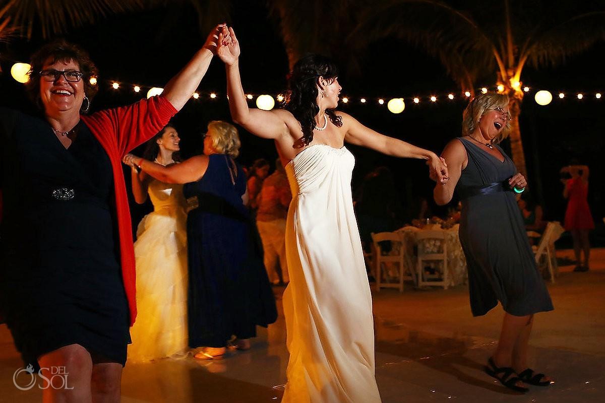 bride and mothers dance at hacienda tres rios wedding reception