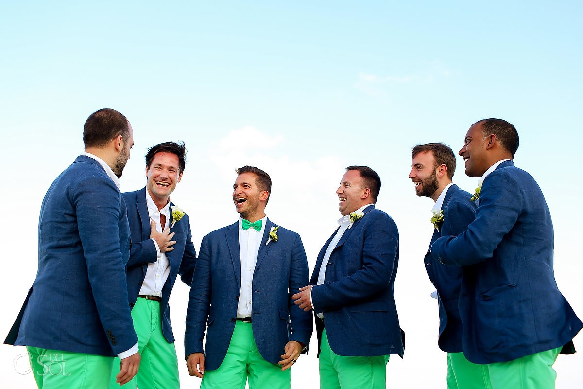 Now Sapphire Resort Beach Wedding ceremony groomsmen in green pants