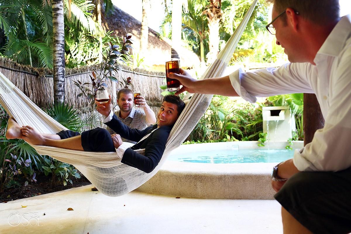 groom getting ready hammock cheers Wedding at Viceroy Riviera Maya
