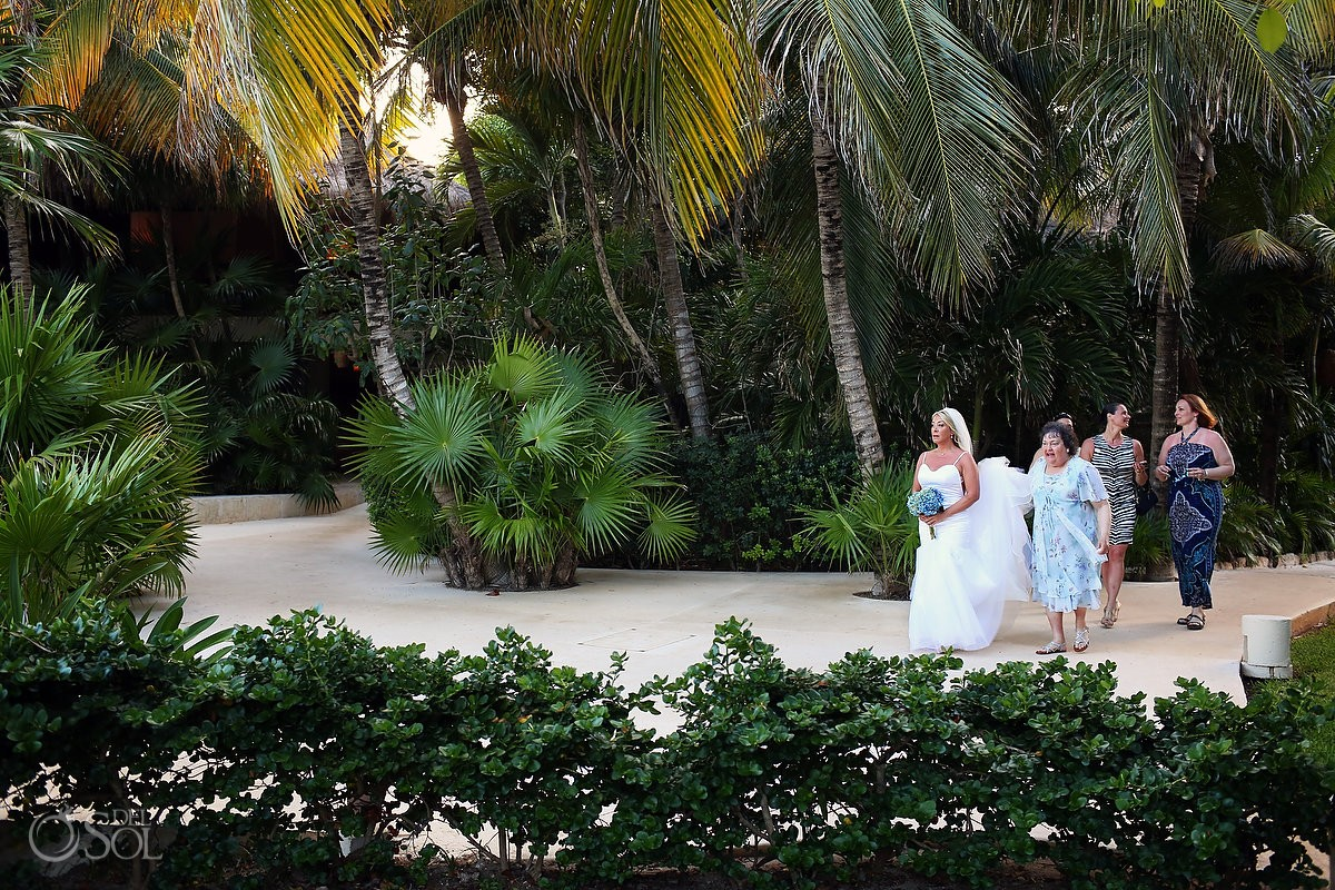 Bride walking to beach wedding ceremony Viceroy Riviera Maya