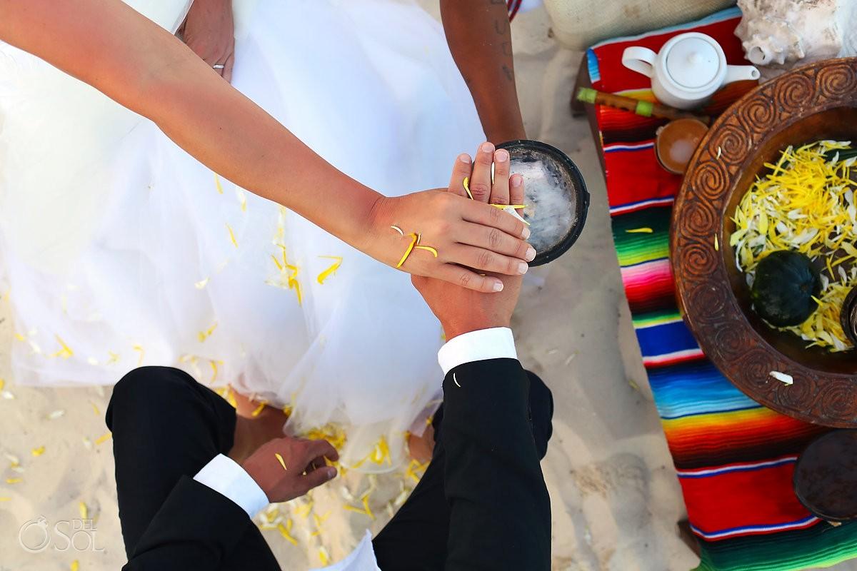 Holding hands detal bowls Mayan beach wedding Viceroy Riviera Maya Mexico