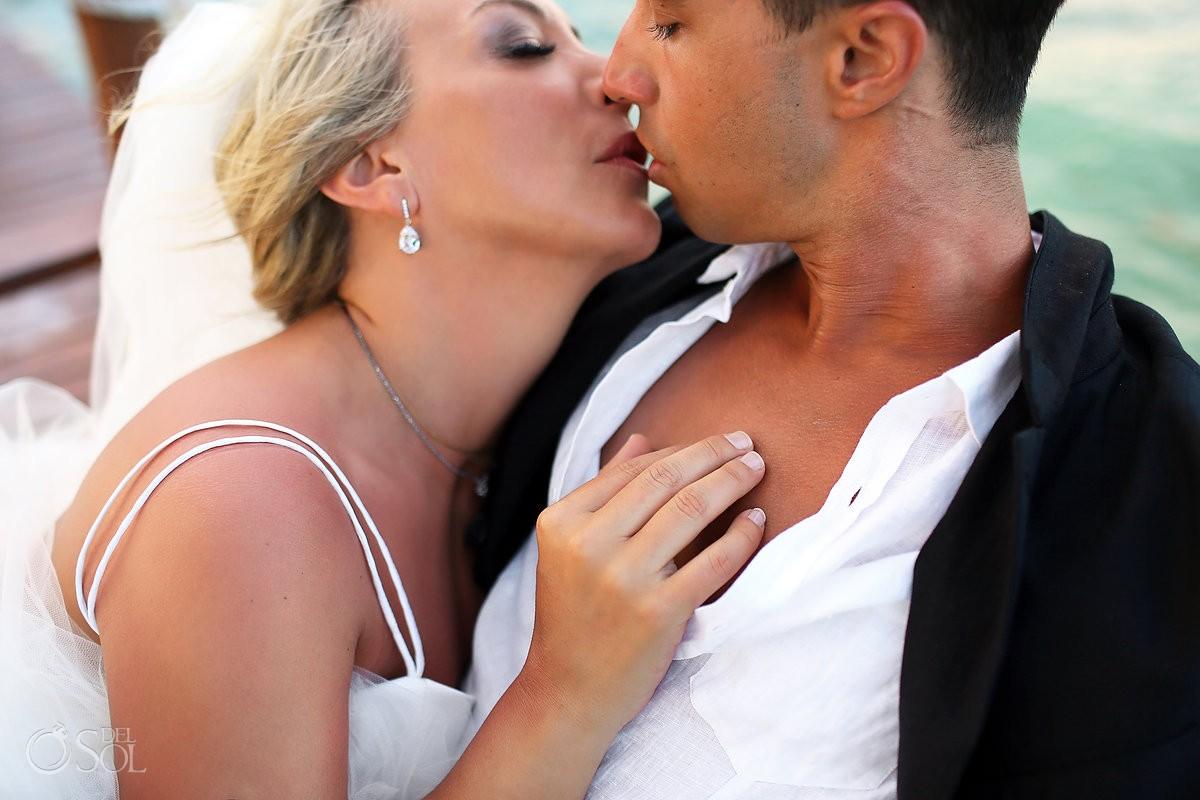 Bride groom kiss candid wedding portrait beach Viceroy Riviera Maya Mexico