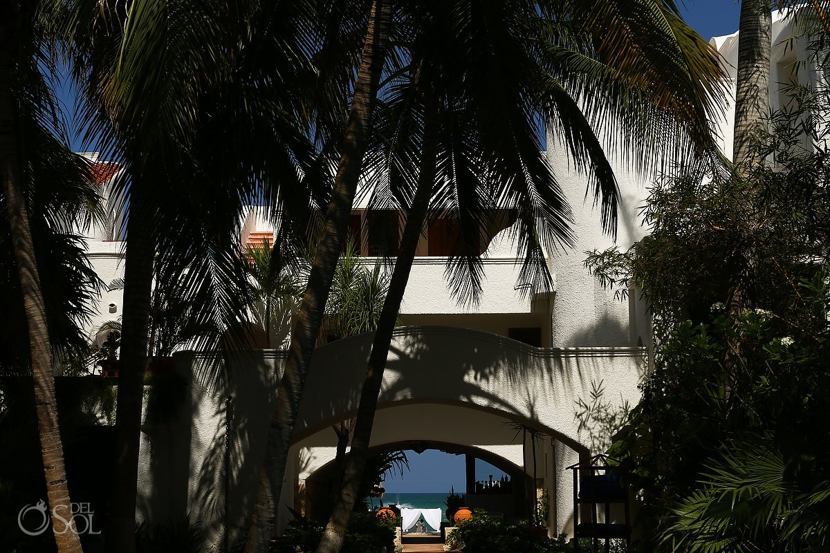 Through the arch at belmond maroma resort and spa destination wedding