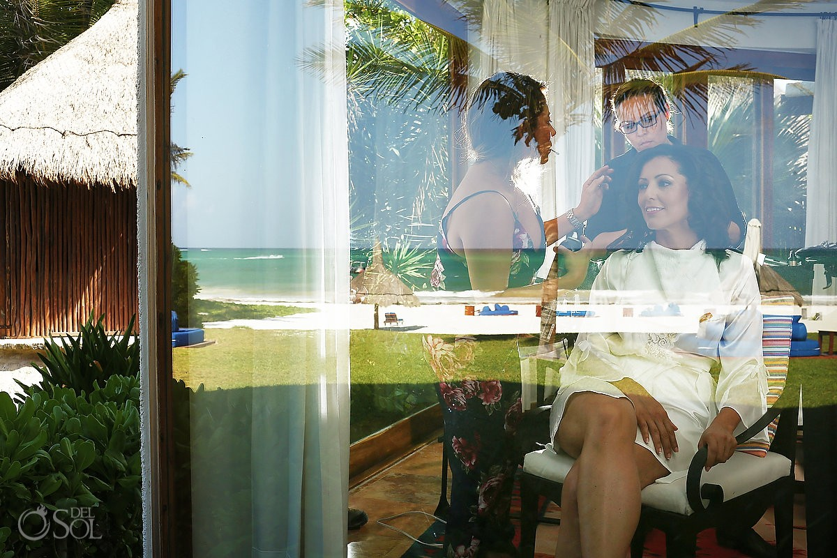 Bride getting ready with beach and reflections of caribbean ocean at belmond maroma resort