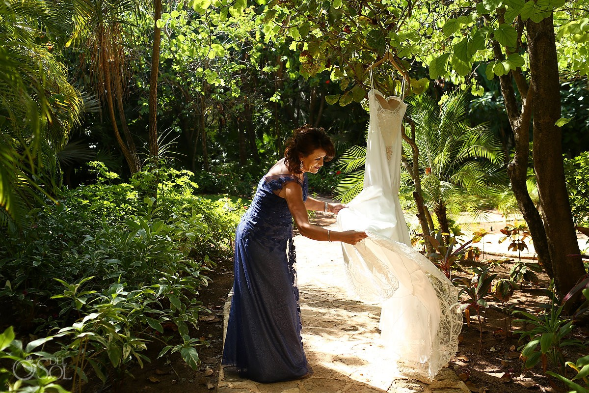 mother of bride hanging wedding Gown in Belmond Maroma Resort gardens, gown byGalia Lahav