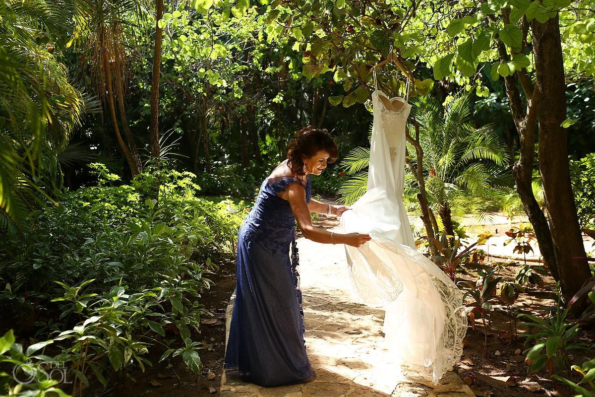 mother of bride hanging wedding Gown in Belmond Maroma Resort gardens, gown byGalia Lahav