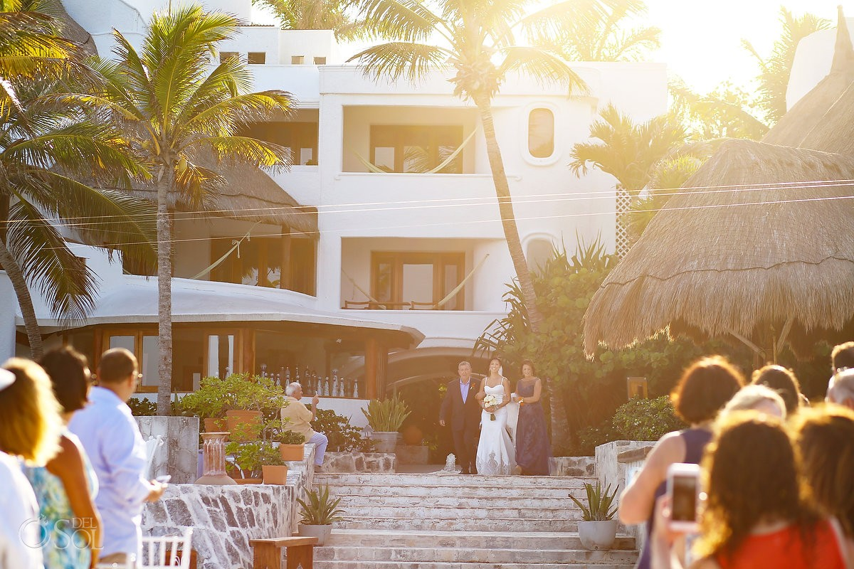 Bride and parents enter wedding processional at belmond maroma resort