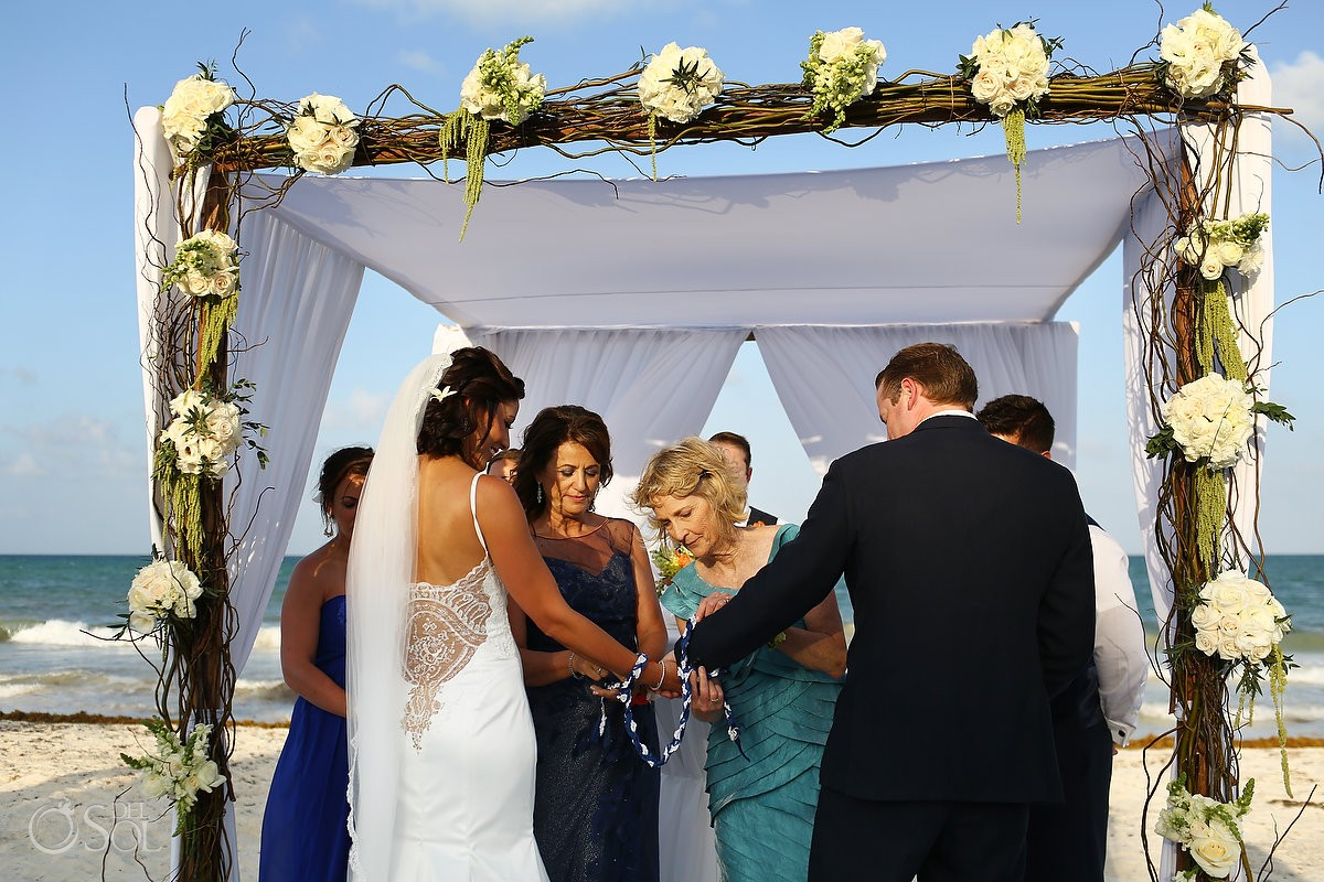 "Bride and groom doing ""handfasting"" ceremony at belmond maroma resort mexico"