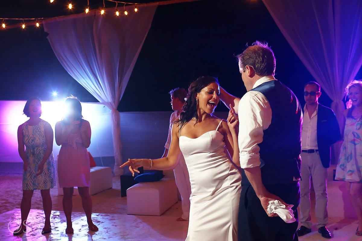 destination wedding photo of bride and groom dancing at belmond maroma resort and spa