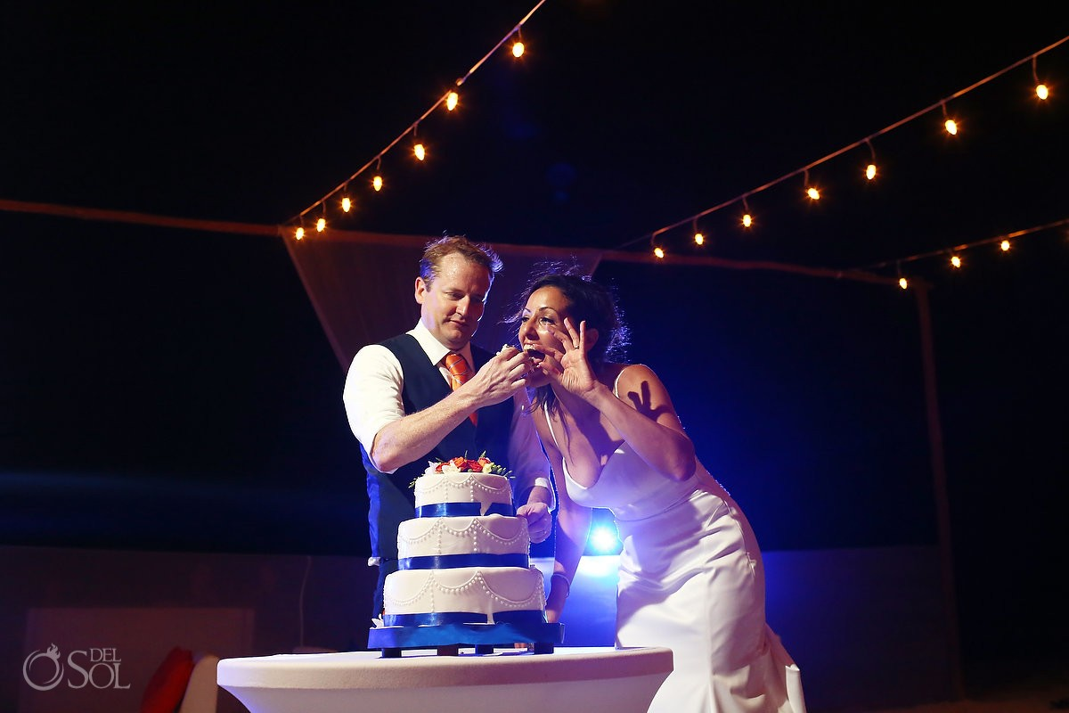 bride and groom cutting the cake at belmond maroma resort and spa
