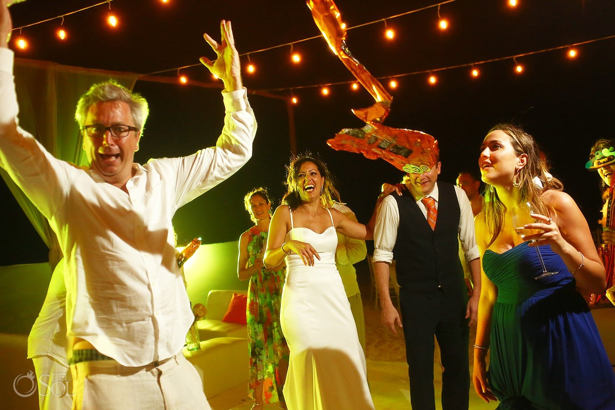 wedding guests dancing on the beach at night in Belmond Maroma Resort and spa Mexico