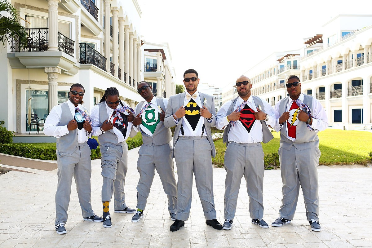 groomsmen with super hero T-shirts posing published huffington post weddings