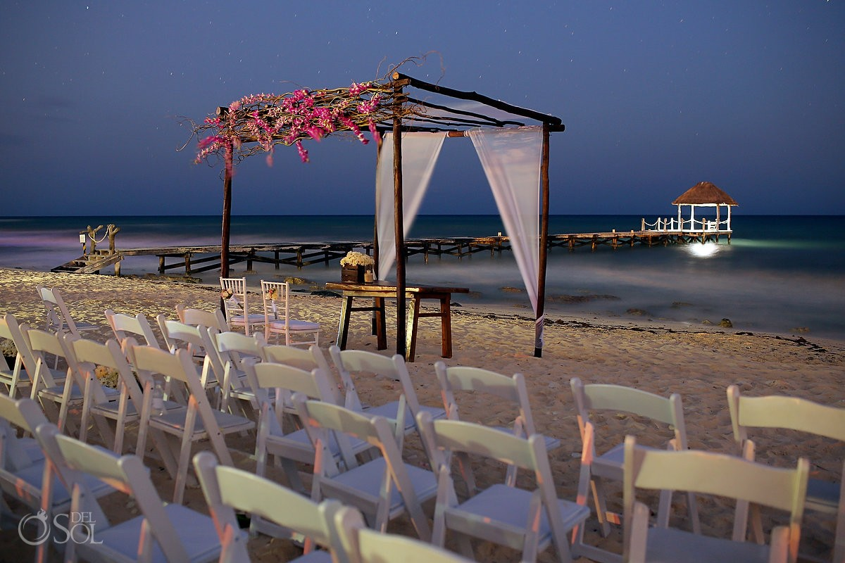 beach atvViceroy hotel night destination wedding photo in front of caribbean ocean