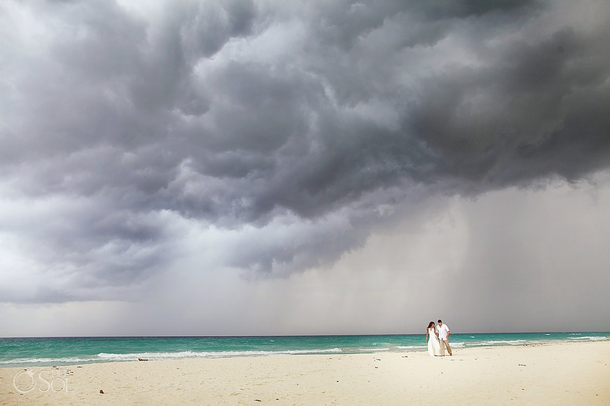 destination wedding photo in the rain in Playa del Carmen mexico