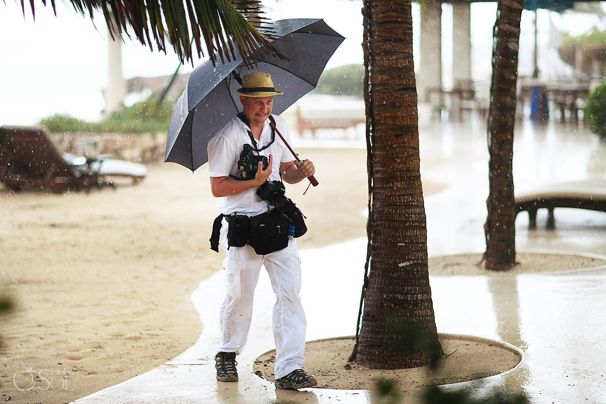 Photographer Matt Adcock toughs out the rain at the Viceroy Hotel, Riviera Maya