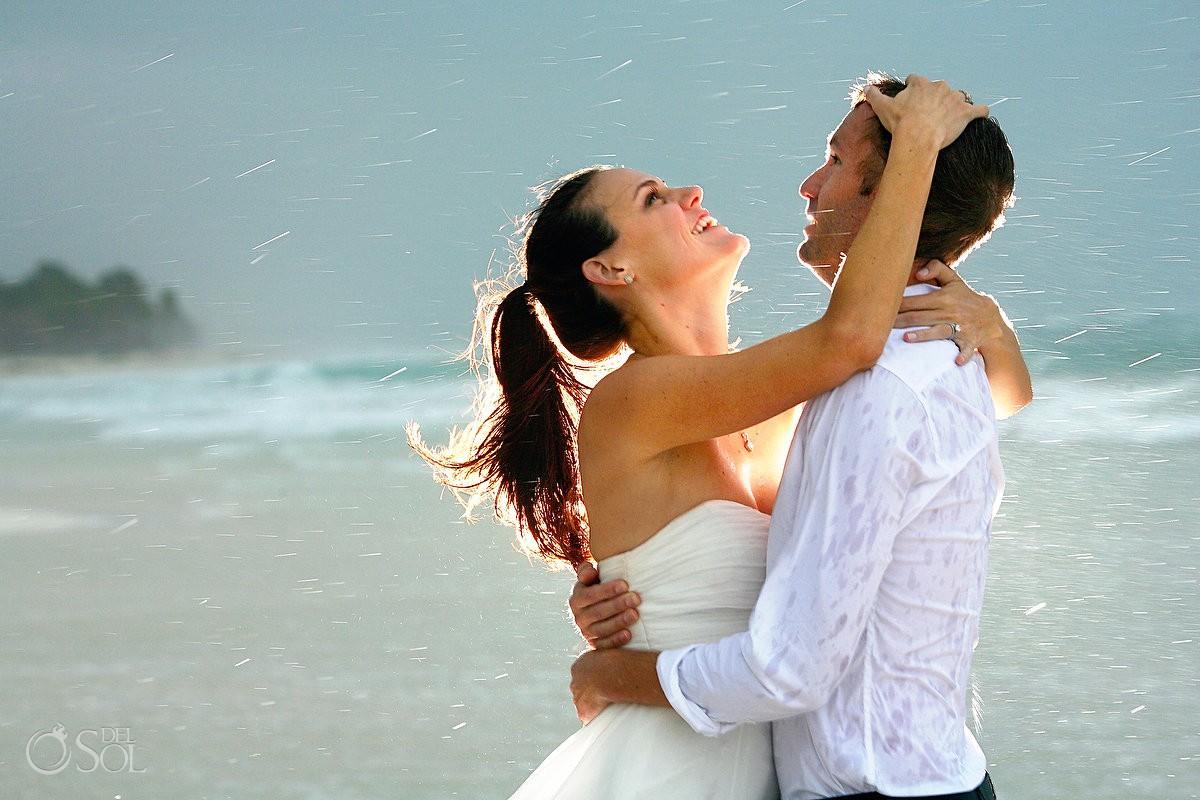 bride and groom in the rain in tulum beach mexico
