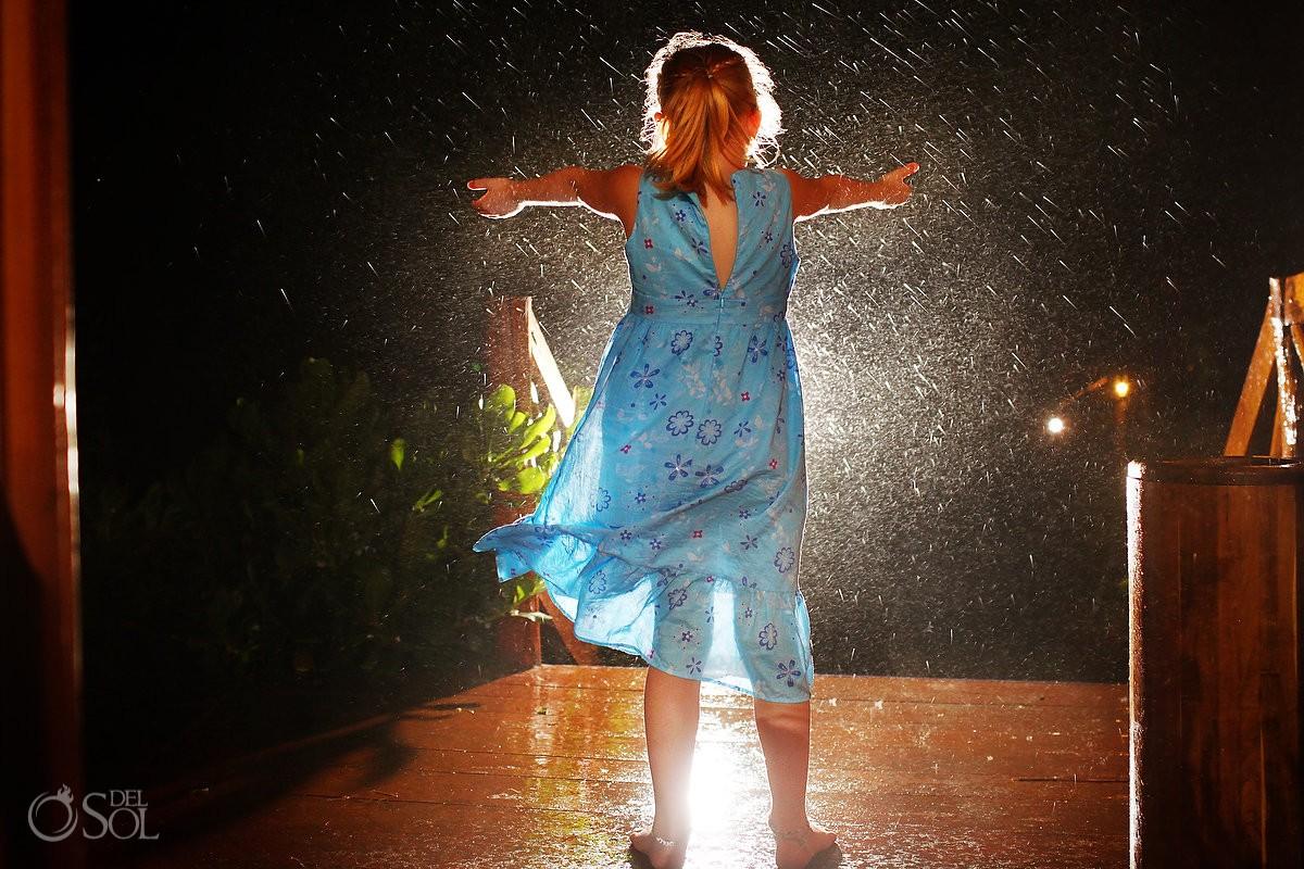 wedding guest in the rain at el pez hotel tulum