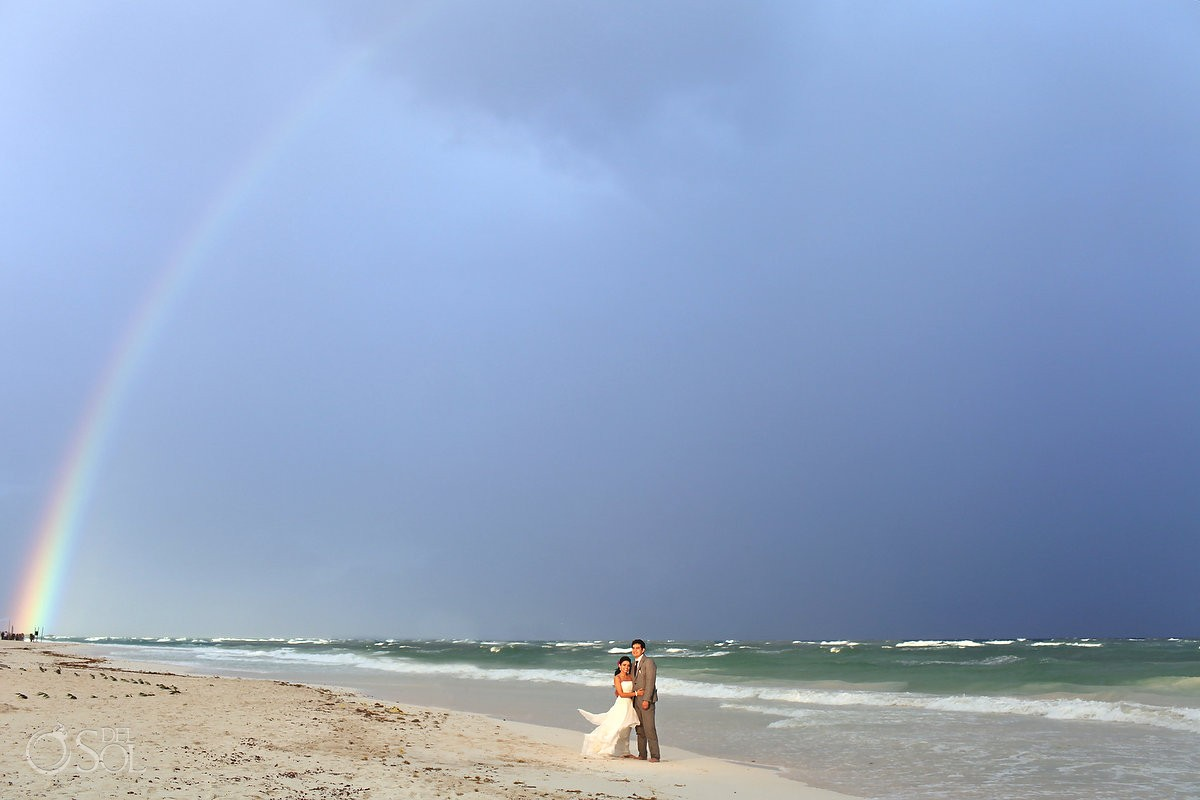 destination wedding photo of bride and groom on tulum beach with rainbow