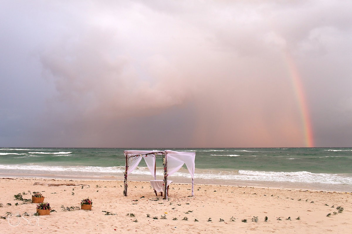 Destination wedding photo with rainbow at Akin Beach Tulum
