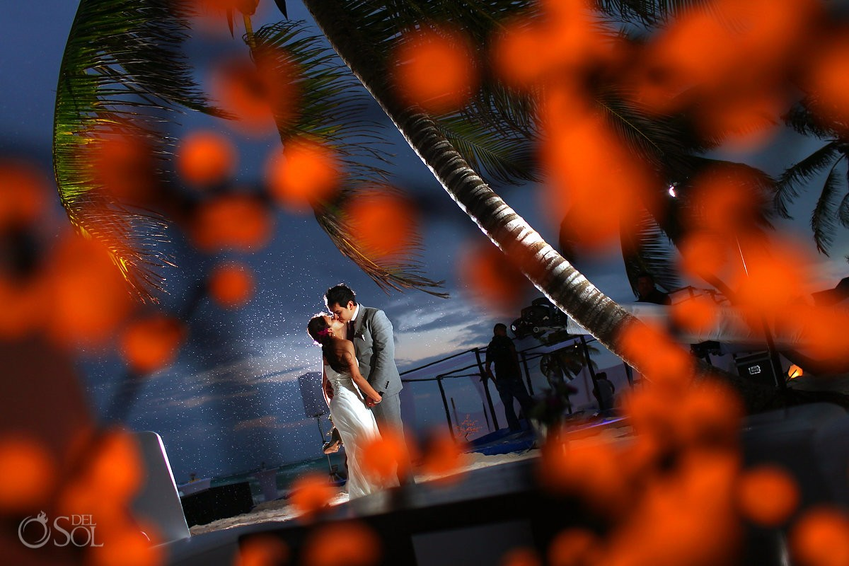 bride and groom posing in the rain at akiin beach tulum hotel
